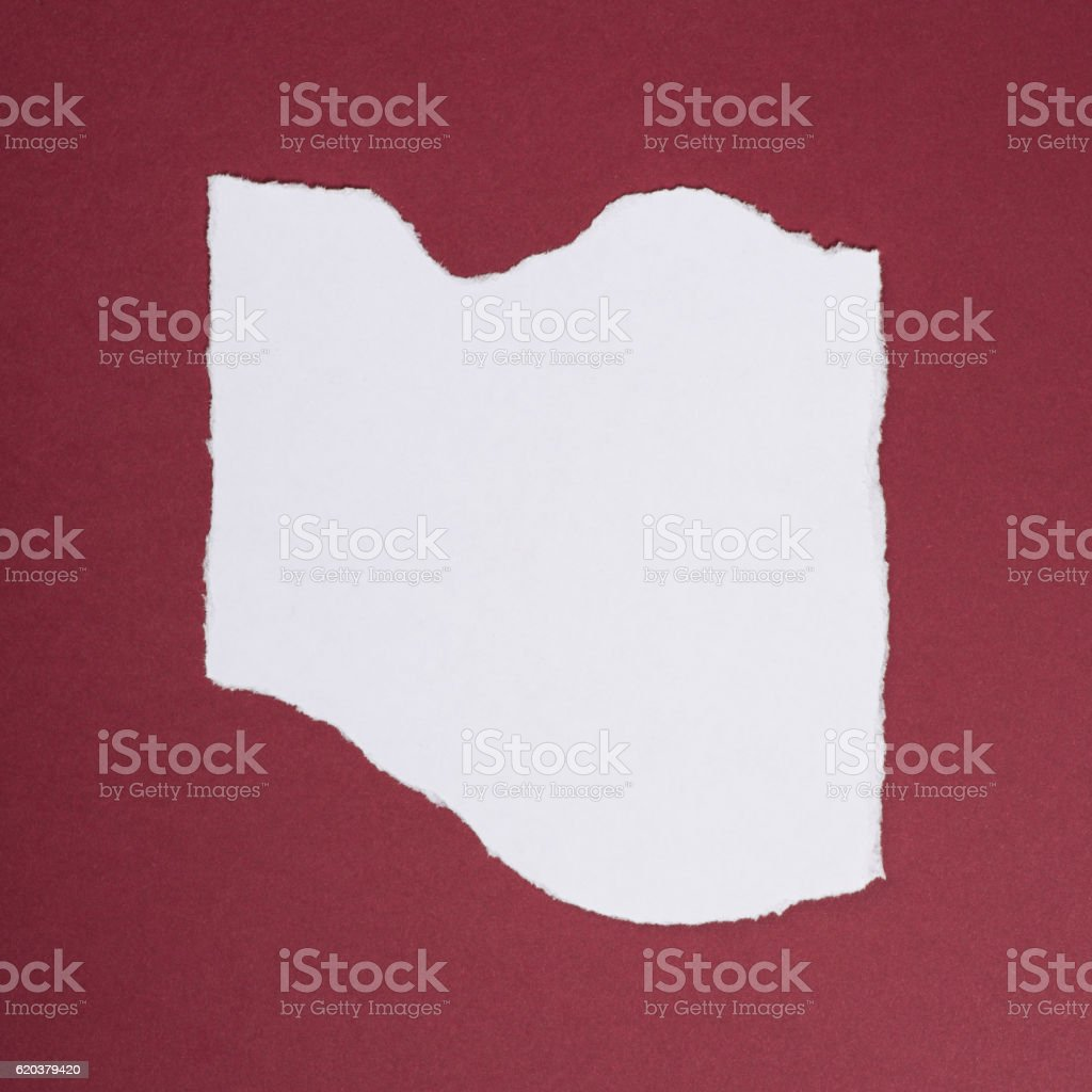 Piece of torn paper over the dark red background foto de stock royalty-free