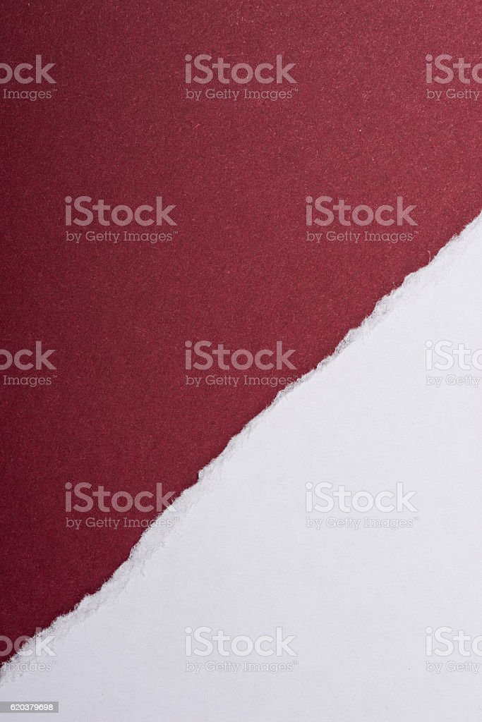 Piece of torn paper over the dark red background zbiór zdjęć royalty-free