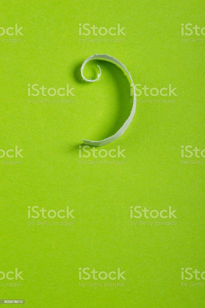 Piece of torn paper over the green background zbiór zdjęć royalty-free