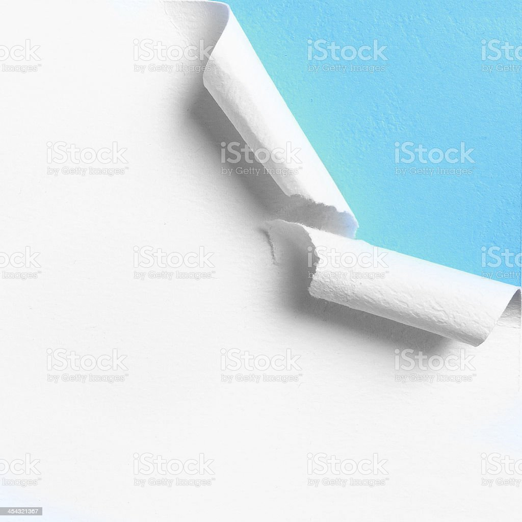 Piece of white paper with torn hole edge stock photo