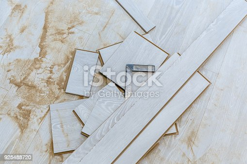 922081754 istock photo A piece of wood shot nails pieces of laminate 925488720