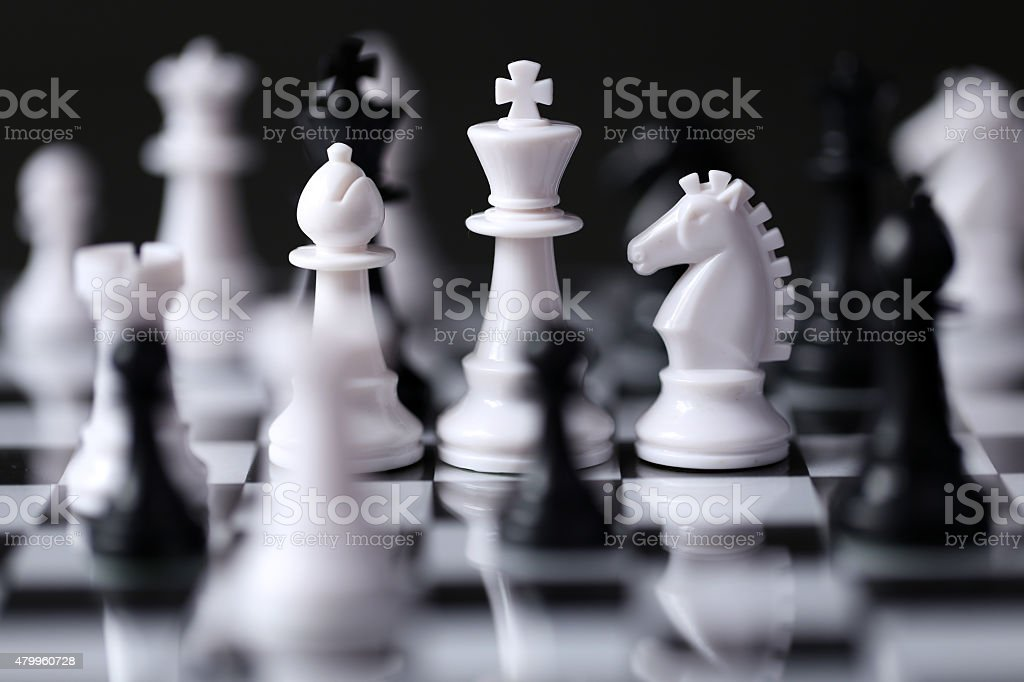 Piece on a chess board, black and white stock photo