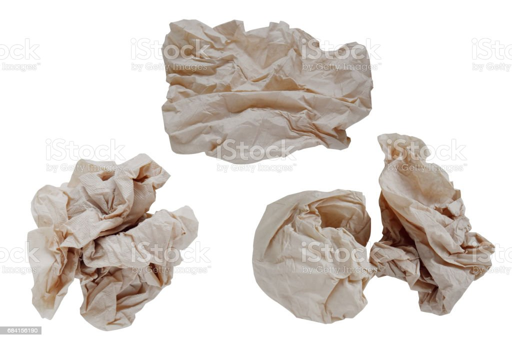 Piece paper napkin brown,isolated on white background with clipping path. zbiór zdjęć royalty-free