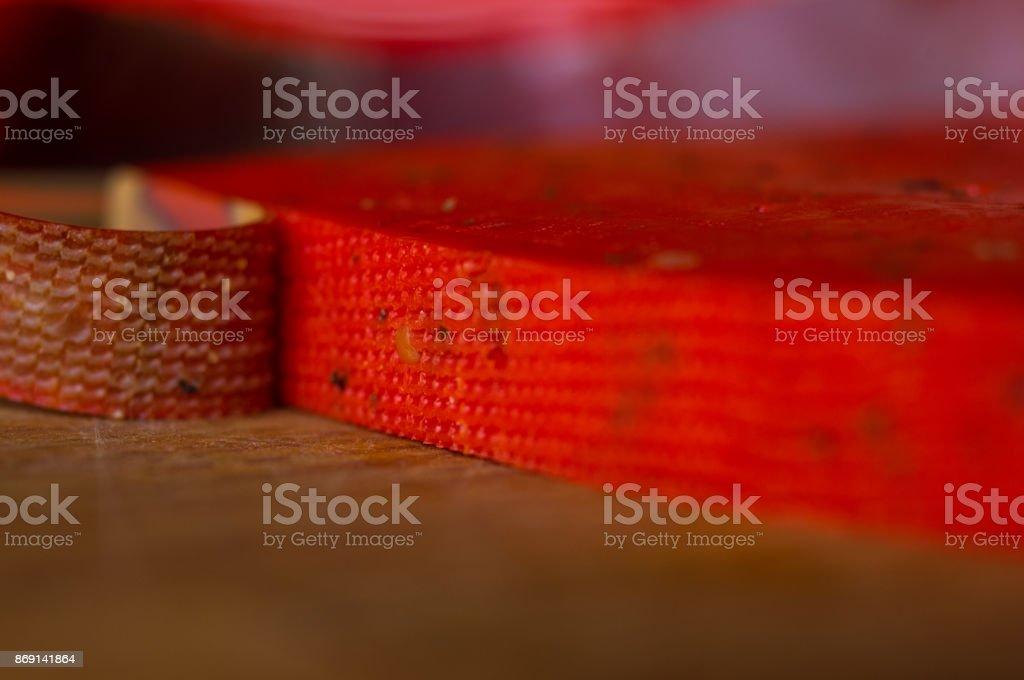 Piece solid red Pesto cheese Basiron stock photo