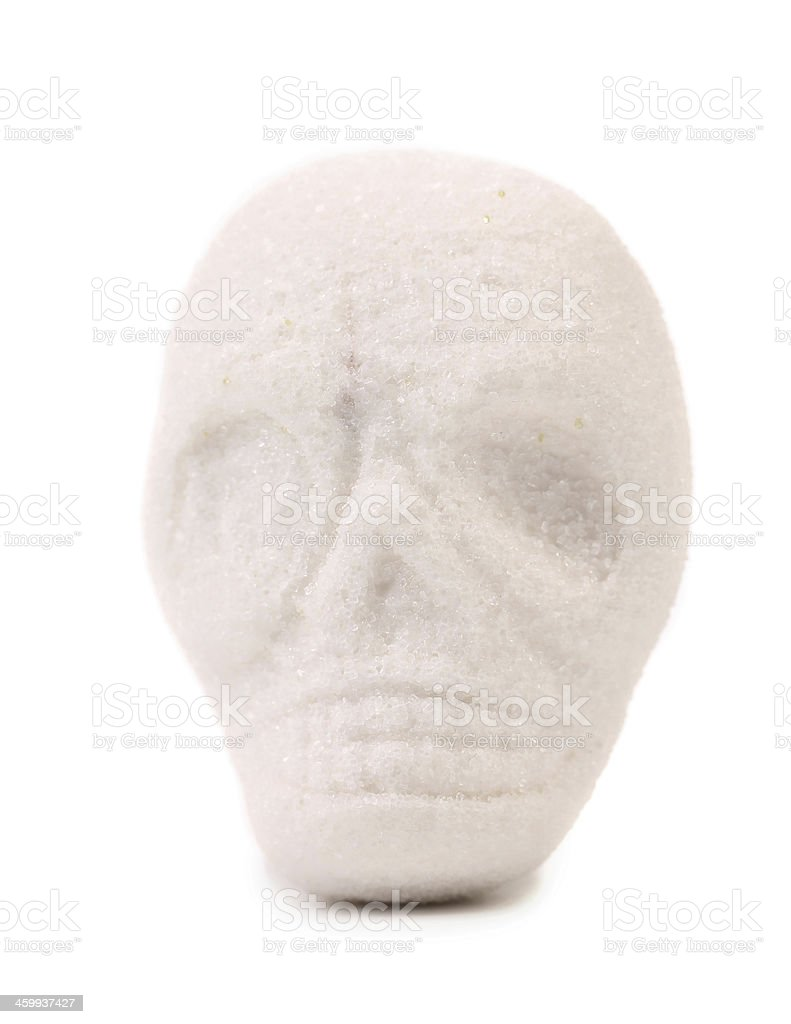 Piece sugar in form of skull. stock photo