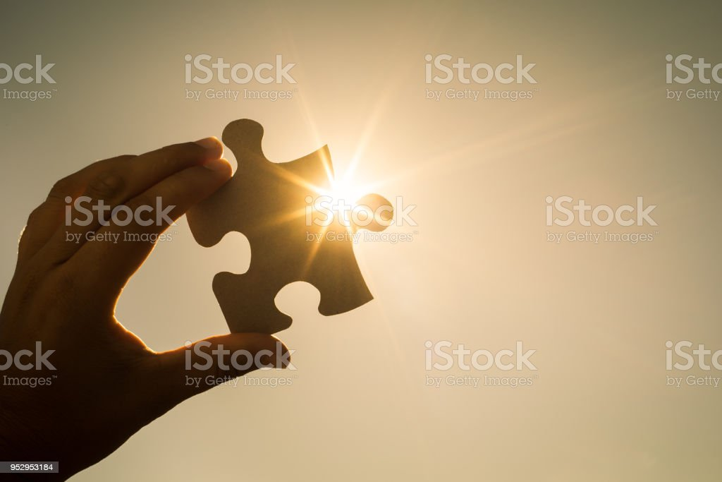 Piece to the puzzle stock photo