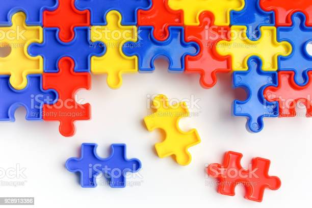 Pieces from a colorful jigsaw puzzle arranged to form a page on white picture id928913386?b=1&k=6&m=928913386&s=612x612&h=y460w3offxxxhw6 qrom26eyqvrgpjtzbghlrzehn i=