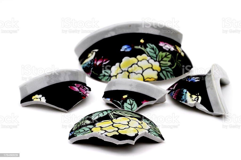 Pieces of a broken ceramic vase stock photo