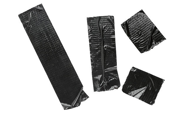 pieces of black duct tape isolated on white - adhesive tape stock photos and pictures