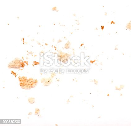 Crumbled pieces of bread on white background