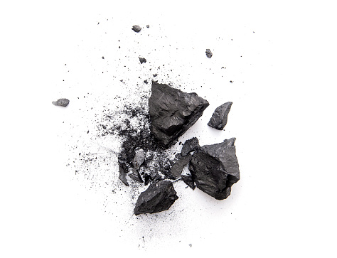 Pieces of broken black coal isolated on white background