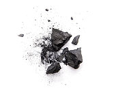 istock Pieces of broken black coal isolated on white background 1264055104