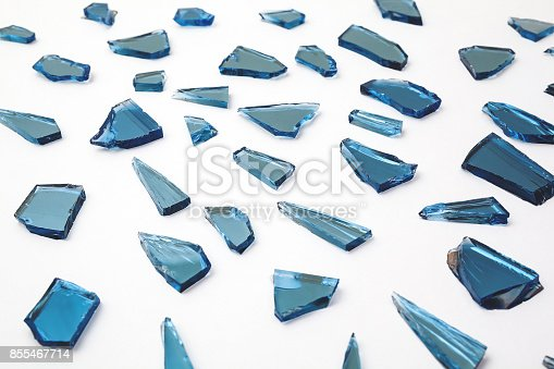 istock pieces of broken glass window on white backgrounds, close up of broken glass 855467714