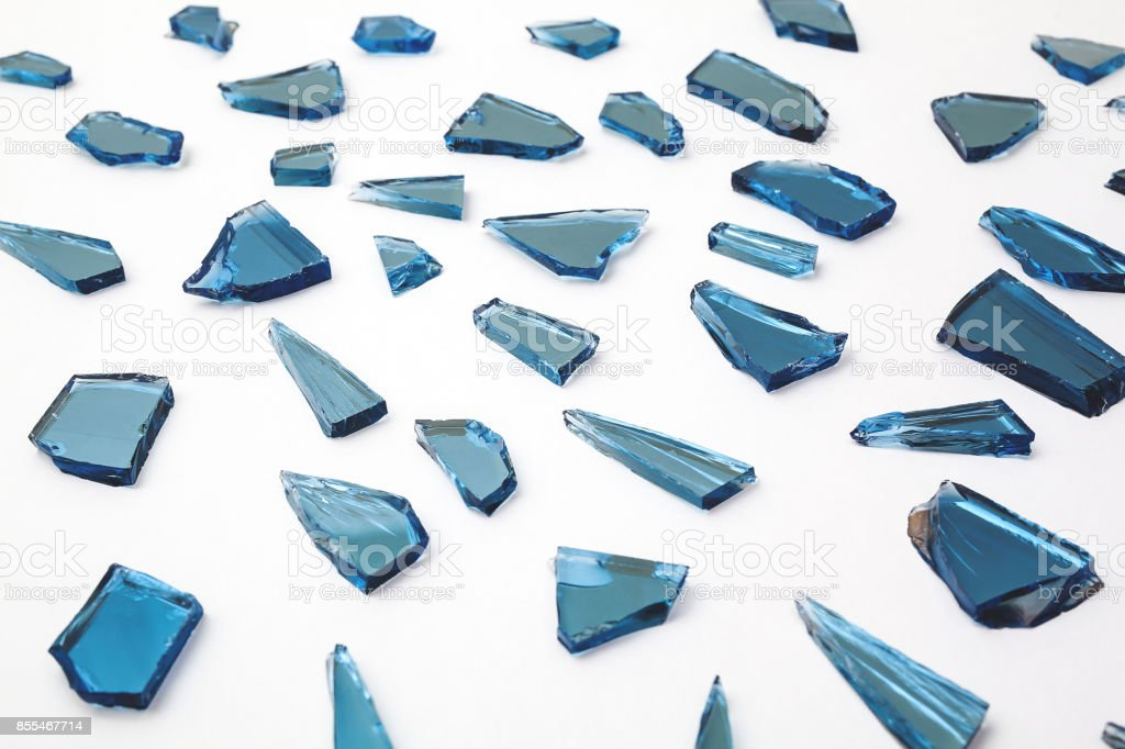 pieces of broken glass window on white backgrounds, close up of broken glass stock photo