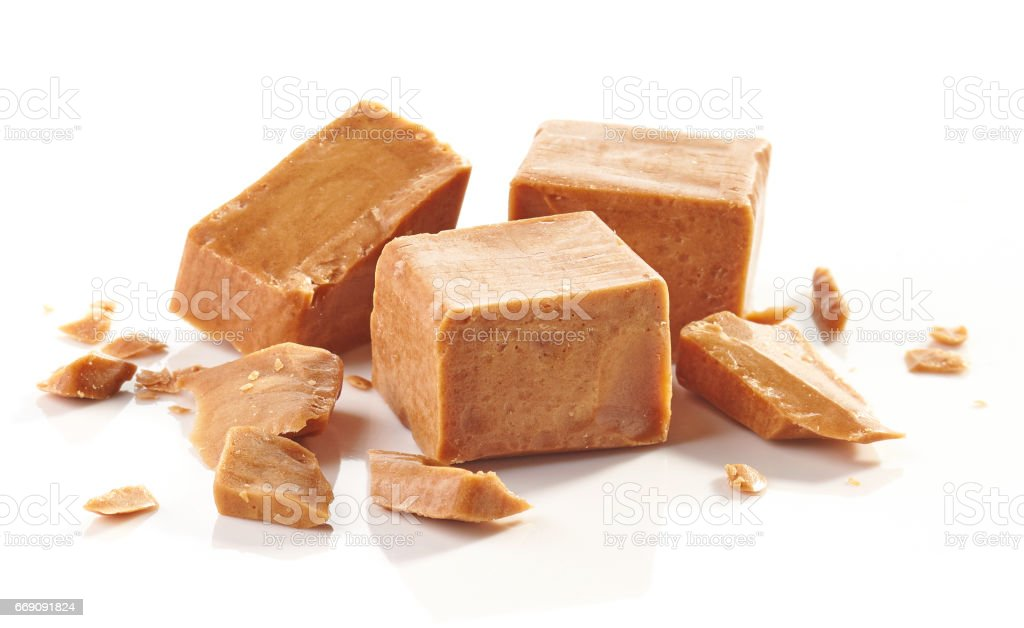 pieces of caramel candies stock photo