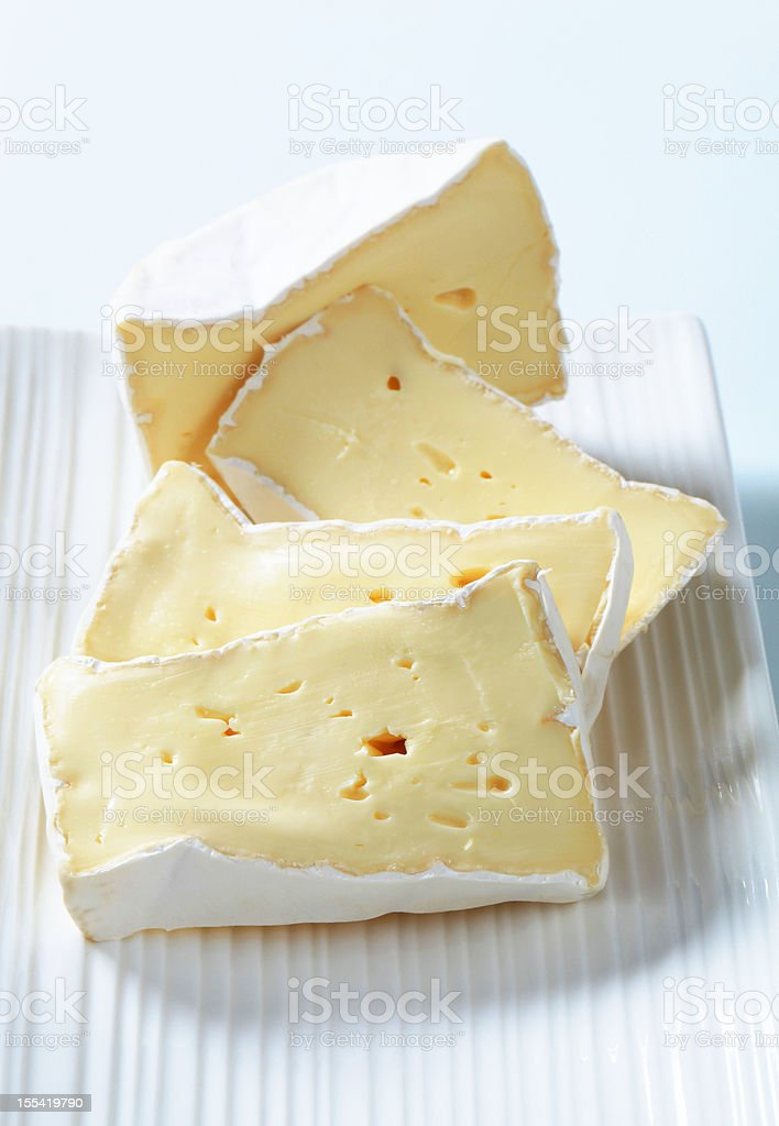 Pieces of cheese brie on a tray stock photo