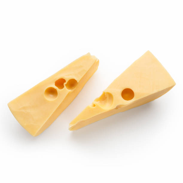 pieces of cheese on white - maasdam foto e immagini stock