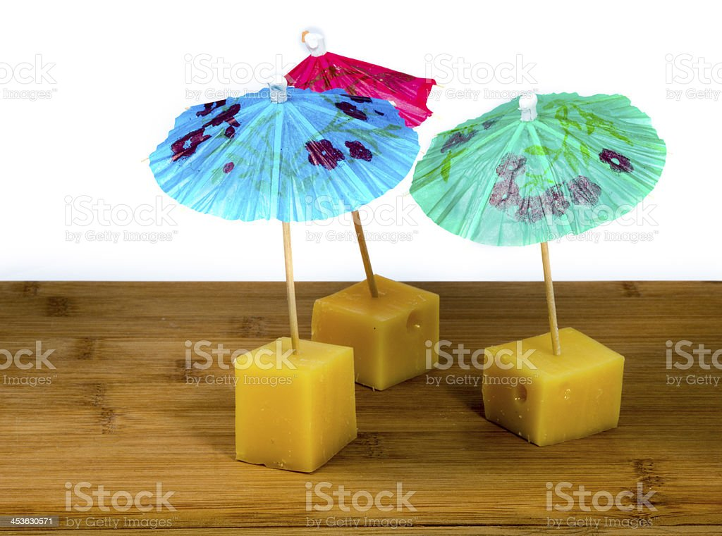 pieces of cheese with unbrella royalty-free stock photo