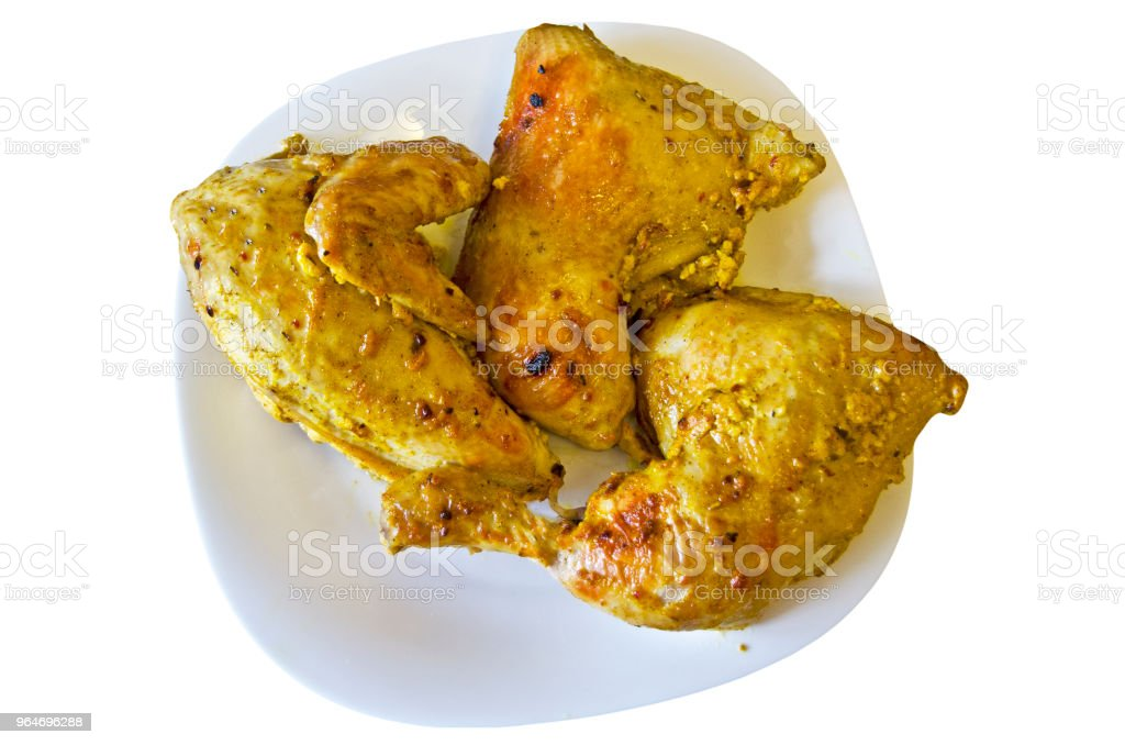 Pieces of chicken grilled in a plate, on white background royalty-free stock photo