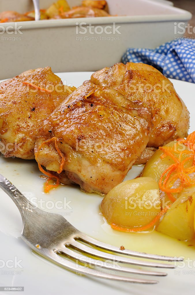 Pieces of chicken with potatoes stock photo
