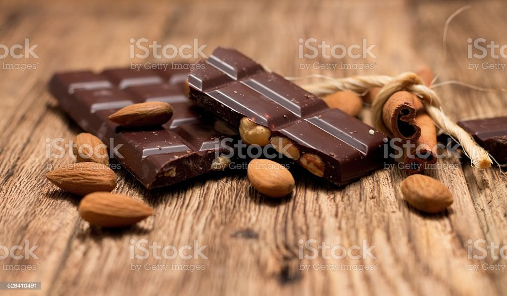 Pieces of chocolate and cinnamon stock photo