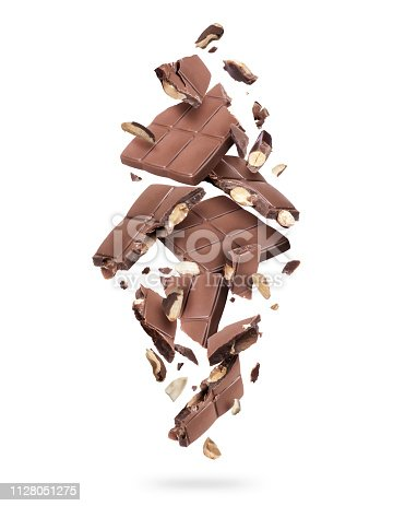 istock Pieces of chocolate bar with nuts falling down on white background 1128051275