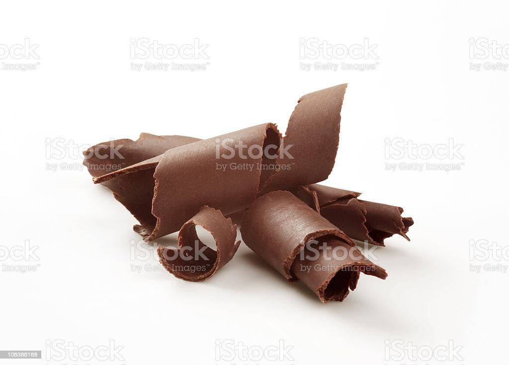 Pieces of chocolate curls on white background royalty-free stock photo