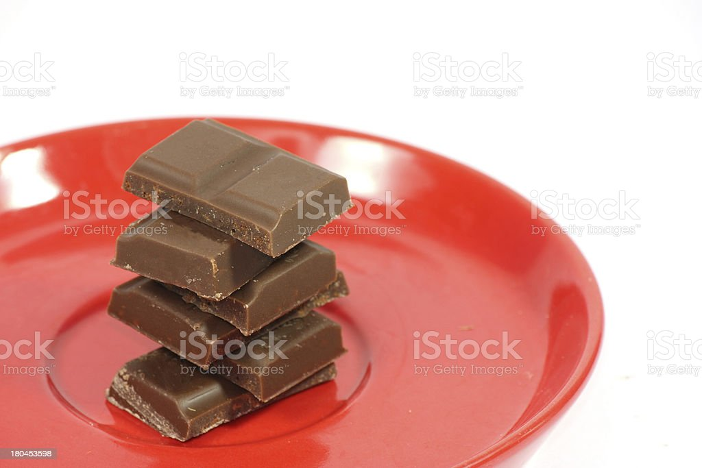 pieces of chocolate on plate stock photo