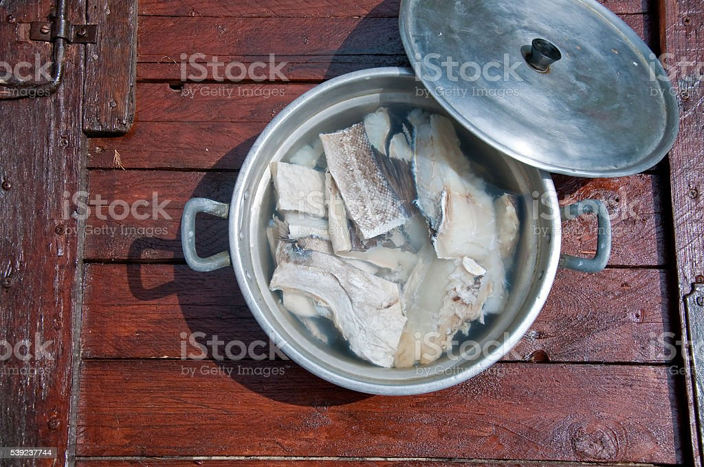 pieces of codfish put nel'acqua ready to be cooked royalty-free stock photo