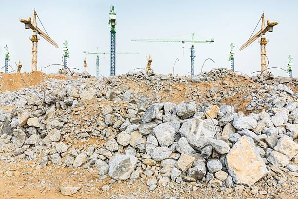 pieces of concrete and brick rubble debris on construction site - betonwerkstein stock-fotos und bilder