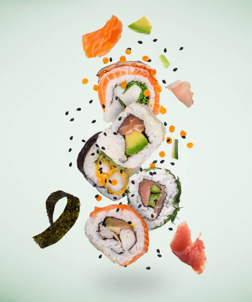 Pieces of delicious japanese sushi frozen in the air. stock photo