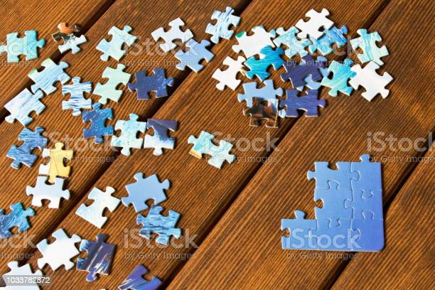 Pieces of different puzzles on a wooden table the concept of thinking picture id1033782872?b=1&k=6&m=1033782872&s=612x612&h=gwq4mtm om2vxqdh7mg6xuijgrgj2skq25xywr0vl00=