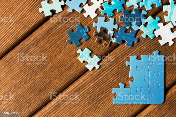 Pieces of different puzzles on a wooden table the concept of thinking picture id993722230?b=1&k=6&m=993722230&s=612x612&h=h4hyok1iebhdbvijf6r6s4rr6lnvk7svxkjks1hjzt4=