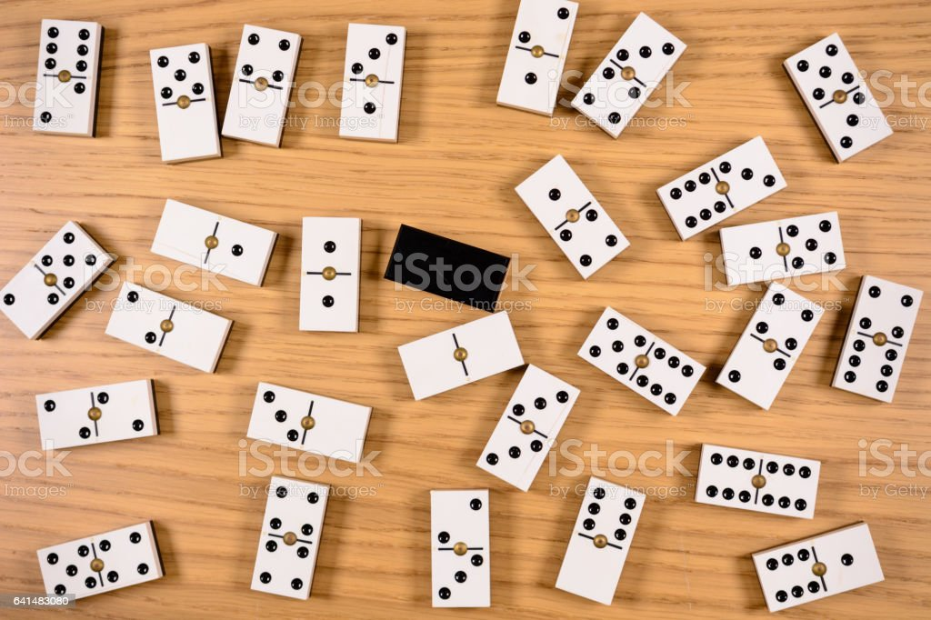 pieces of domino on wood with space for text stock photo