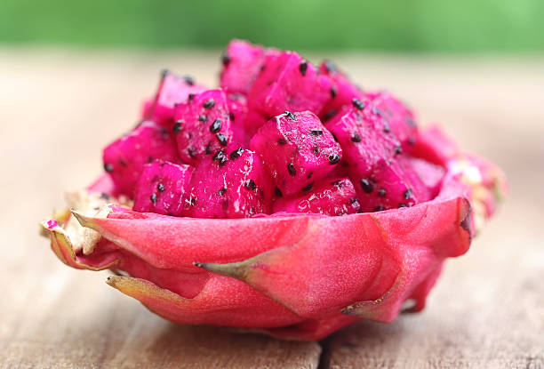 Pieces of dragon fruit Pieces of dragon fruit on wooden surface pitaya stock pictures, royalty-free photos & images