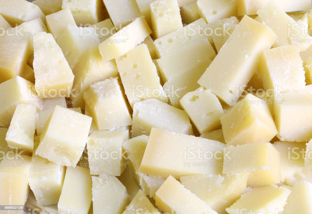 pieces of fresh cheese all cut into cubes during the buffet - foto stock