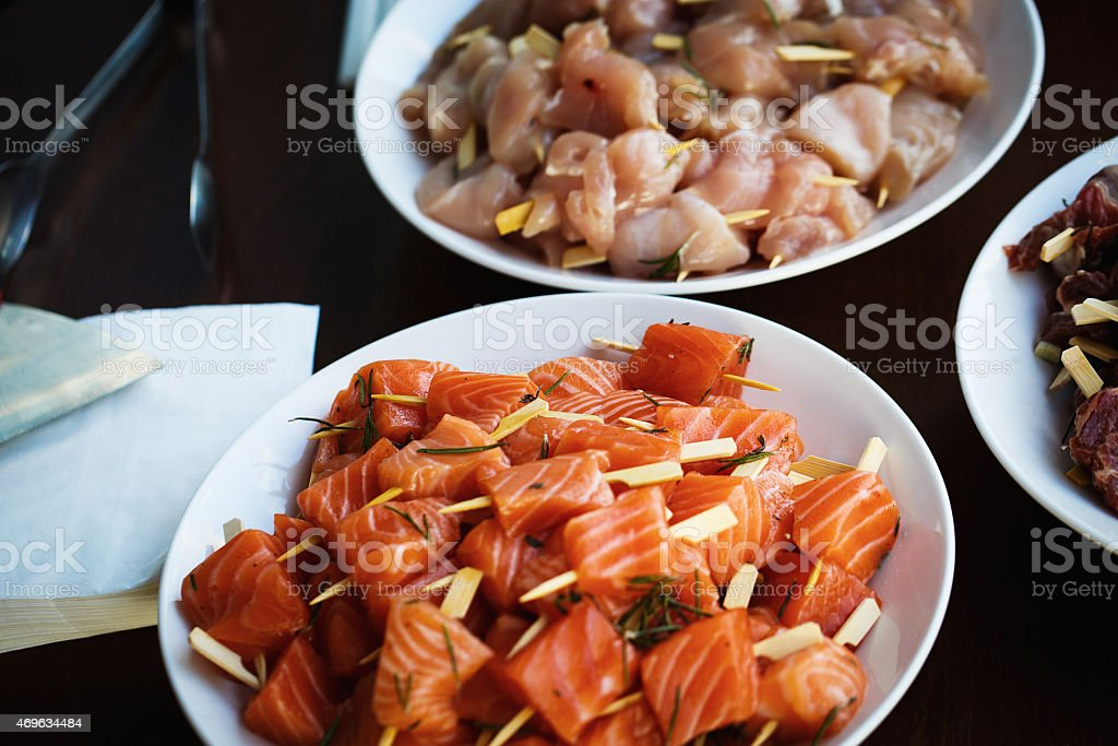 Pieces of fresh meat and fish stock photo