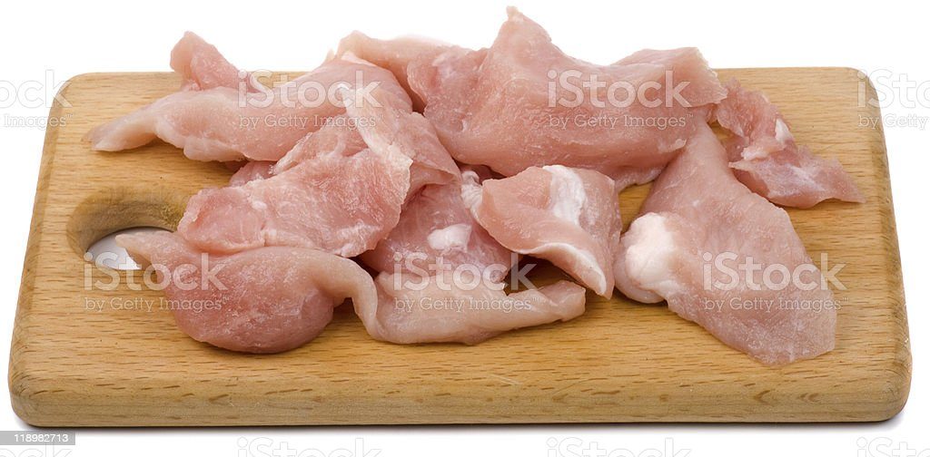 Pieces of fresh meat on cutting board royalty-free stock photo
