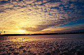 Pieces of frost on frozen Lake Elckie, lit by the setting sun. Winter landscape. Masuria, Poland.