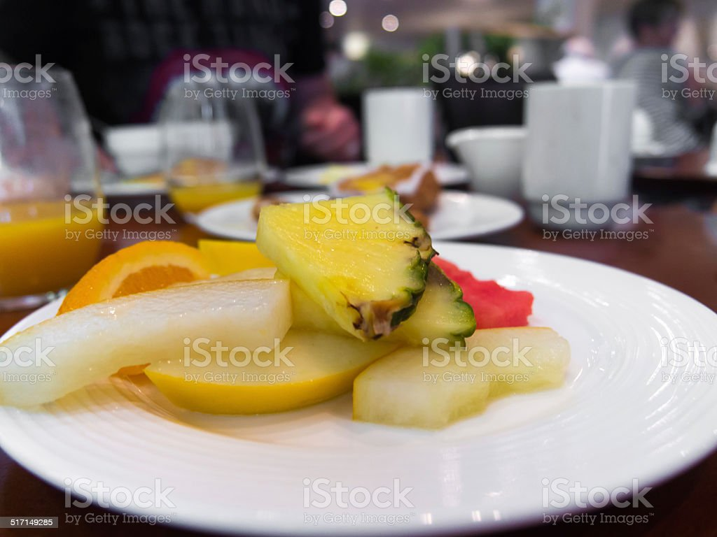 Pieces of fruit on a plate stock photo