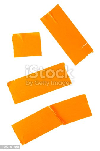 Pieces of orange duct tape isolated on white background.