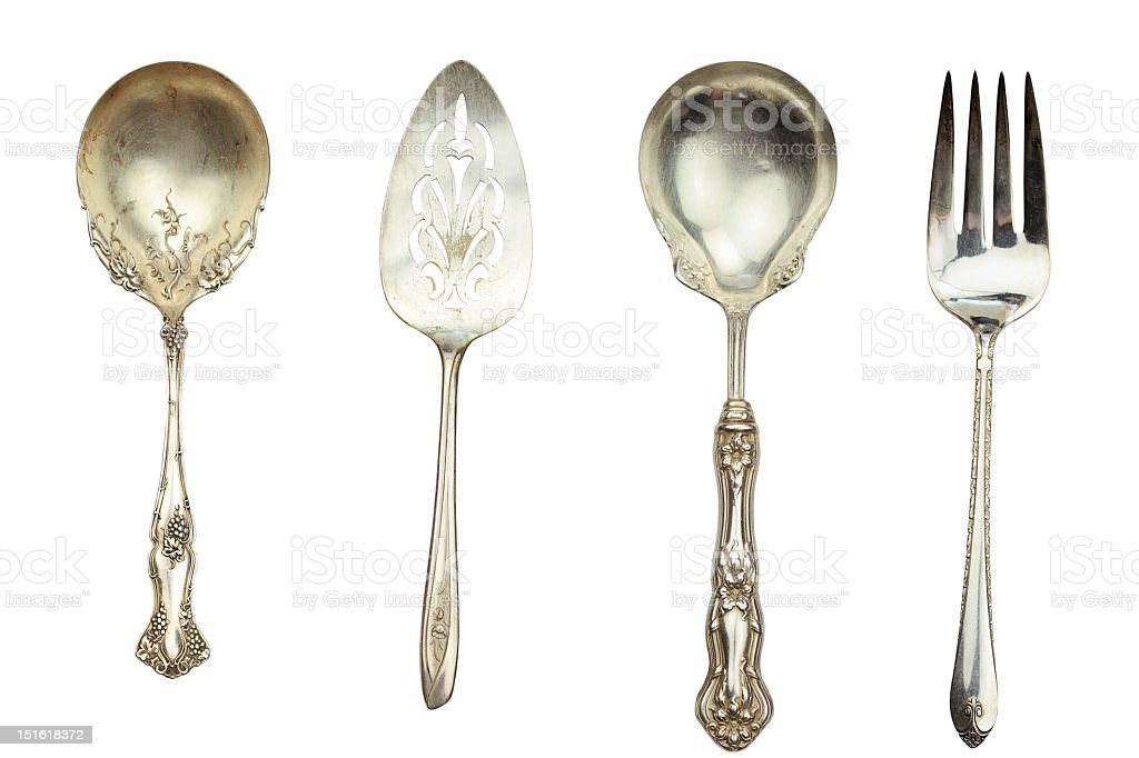 4 pieces of ornate silver decorative tableware stock photo