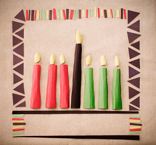 Pieces of paper cut out and placed on paper to make candles stock photo