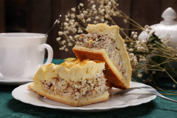 pieces of pie stuffed with canned saury fish and rice on a white plate stock photo