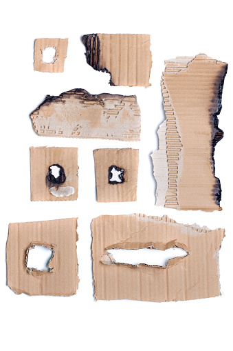 Mixed view of pieces of recycled brown cardboard.