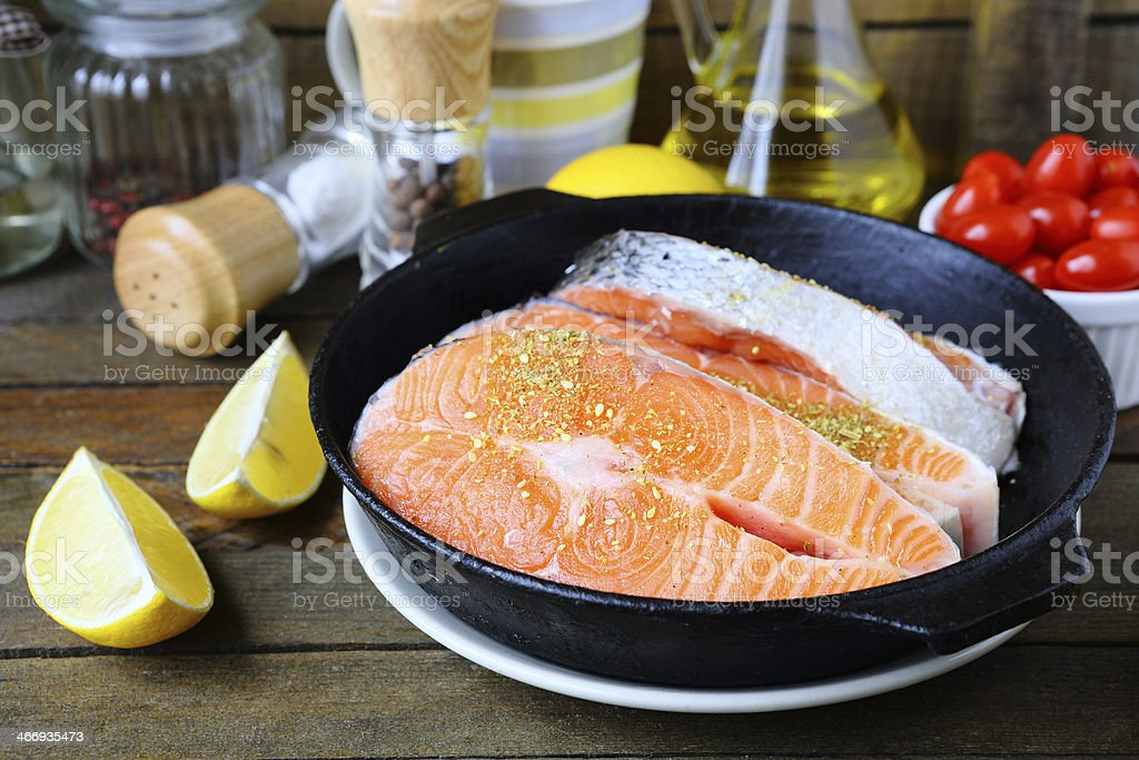 pieces of red fish in the pan, salmon royalty-free stock photo