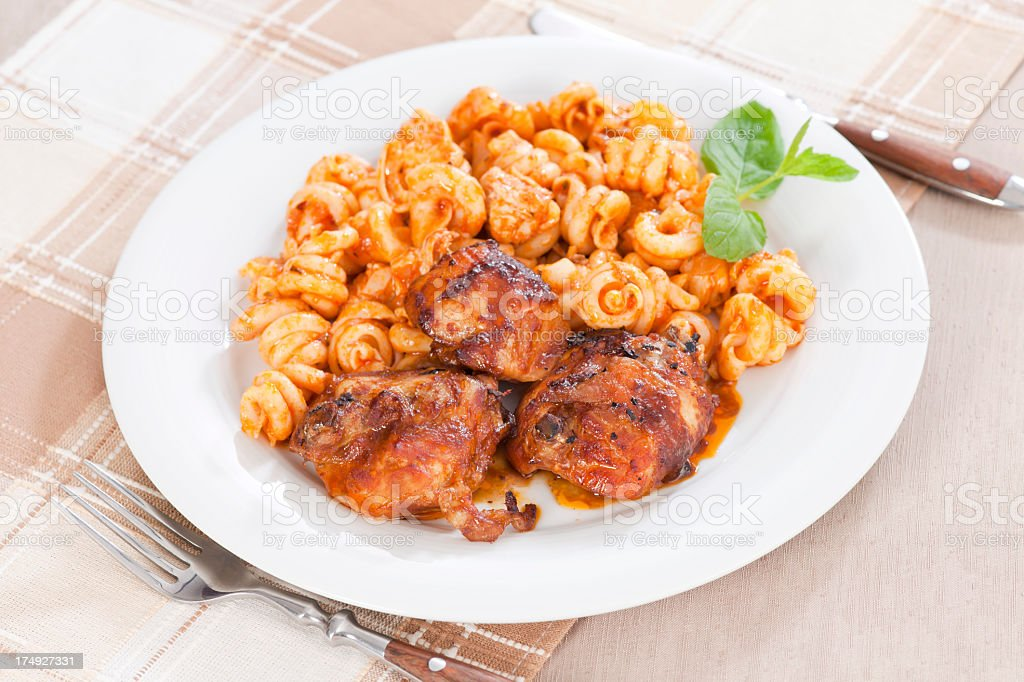 Pieces of roasted chicken with pasta royalty-free stock photo