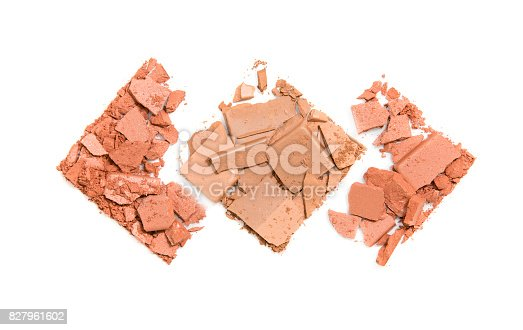 istock Pieces of scattered compact powder on a white background in the form of three rhombuses 827961602