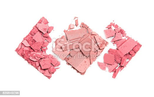 istock Pieces of scattered compact powder on a white background in the form of three rhombuses 839849296