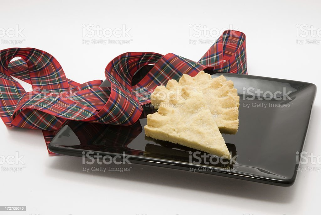 pieces of shortbread on a square black plate royalty-free stock photo